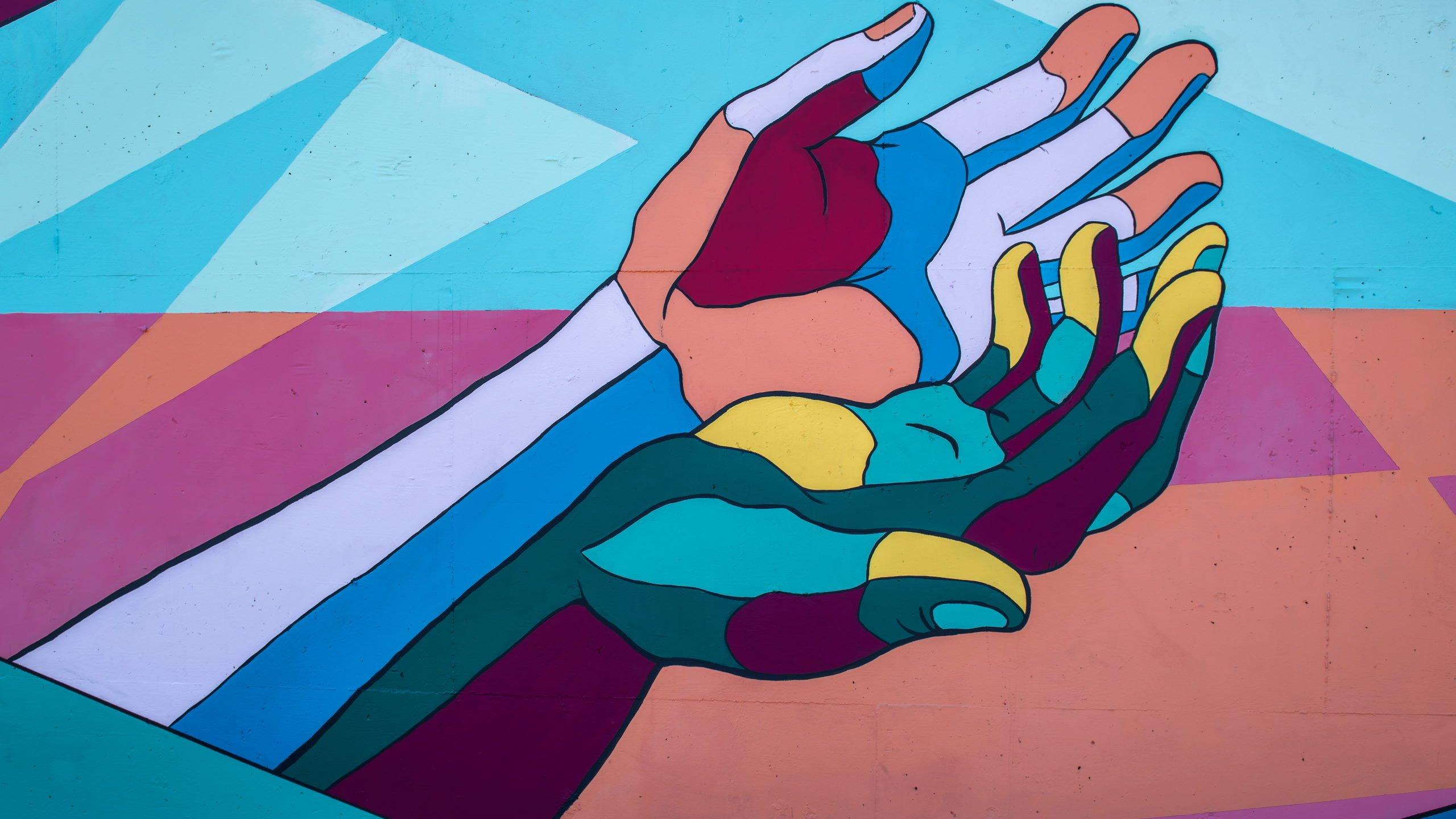 colorful hands help stock unpslash