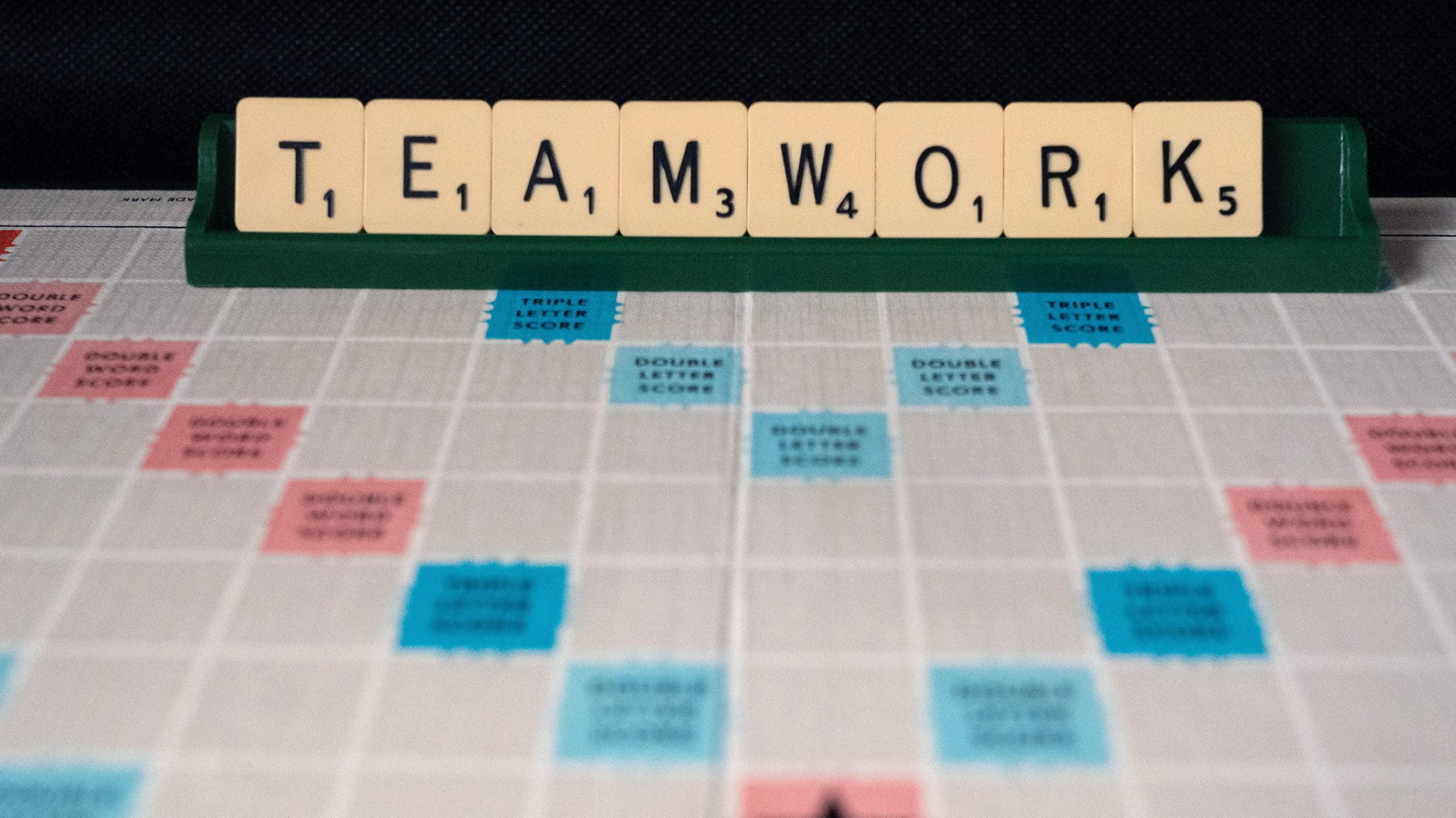 teamwork scrabble stock unsplash