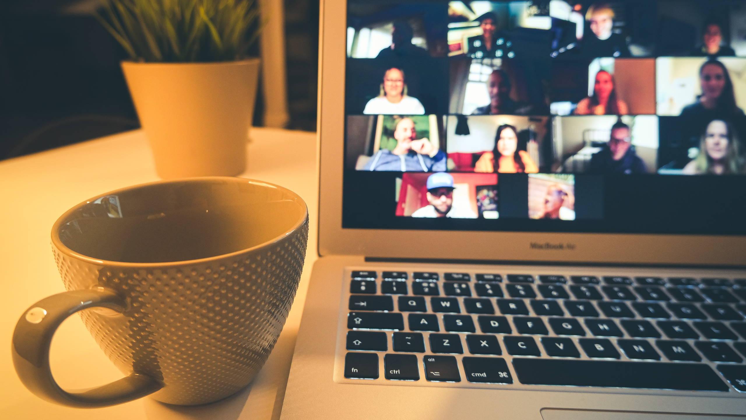 Zoom meeting laptop cup stock unsplash